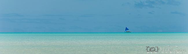 Traditional canoe sailing in lagoon. Tarawa, Kiribati
