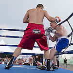 Heavyweight Zhang Zhilei, left, from Henan Province, China, left, fights Curtis Lee Tate from Memphis Tenn. during the Rural Rumble on Friday night, August 8, 2014 at Churchill County Fairgrounds in Fallon, Nevada.  Zhilei knocked out Tate in 17 seconds.