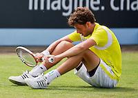 19-06-13, Netherlands, Rosmalen,  Autotron, Tennis, Topshelf Open 2013, , Robin Haase falls to the ground<br /> Photo: Henk Koster