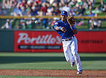 Chicago Cubs' Addison Russell makes a play in a spring training game against the Diamondbacks in Mesa, Ariz., on Thursday, March 17, 2016. The Cubs won 15-4. <br />Photo by Cathleen Allison