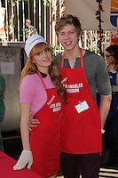 Bella Thorne, Tristan Klier<br /> at The Los Angeles Mission Christmas Eve Celebration, Los Angeles Mission, Los Angeles, CA 12-24-13<br /> David Edwards/DailyCeleb.com 818-249-4998