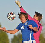 Marion goalkeeper Camden Dodds (right) punches the ball away as Columbia's Karson Bridges leaps and tries to head it into the goal. Columbia defeated Marion 2-0 at Triad High School on Tuesday October 23, 2018 and will advance to the Class 2A sectional final game. <br /> Tim Vizer/Special to STLhighschoolsports.com