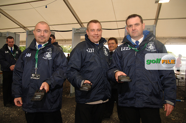 20th September, 2006. Dublin Ireland. Crowds attend the second practise day of the 2006 Ryder Cup at the K Club. From L to R: Michael 'Tommy' Sutcliffe, Mick Brannigan, Malachy McCall on security duty at the above..Photo: Barry Cronin/ Newsfile..