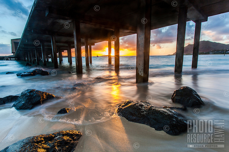 Sunrise behind the Makai Research Pier in Waimanalo, O'ahu.