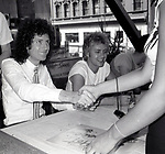 """Brian May and Roger Taylor of Queen attend Queen Press Conference for """"Hot Space"""" at Crazy Eddie's on July 27, 1982  in New York City."""