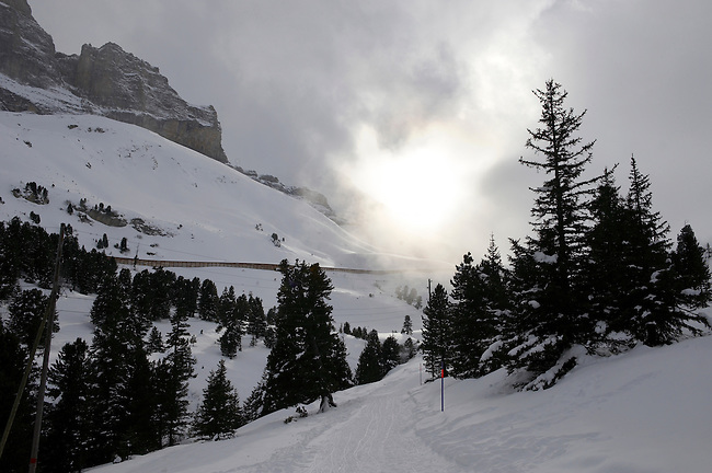 Sun and clouds above the toboggan run from Kleiner Scheidegg to Grindelwald - Swiss Alps - Switzerland