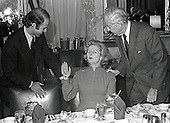 "Washington, DC - (FILE) -- Newly elected British Conservative Party Leader Margaret Thatcher, center, is shown with the Chairman of the United States Senate Foreign Relations Committee, United States Senator John Sparkman (Democrat of Alabama), right, and United States Senator Joseph Biden (Democrat of Delaware), left, as she attends a luncheon in her honor in the Foreign Relations Committee Room in the United States Capitol in Washington, D.C. on Thursday, September 18, 1975.  Mrs. Thatcher is the first woman elected Conservative Party leader.<br /> Credit: Benjamin E. ""Gene"" Forte - CNP"