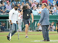 United States Capitol Police Officer David Bailey, who was wounded in yesterday's attack in Virginia goes to meet former New York Yankee manager Joe Torre prior to the 56th Annual Congressional Baseball Game for Charity where the Democrats play the Republicans in a friendly game of baseball at Nationals Park in Washington, DC on Thursday, June 15, 2017. Photo Credit: Ron Sachs/CNP/AdMedia