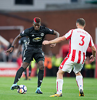 Paul Pogba of Man Utd & Erik Pieters of Stoke City during the Premier League match between Stoke City and Manchester United at the Britannia Stadium, Stoke-on-Trent, England on 9 September 2017. Photo by Andy Rowland.