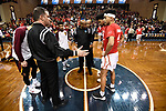 SIOUX FALLS, SD - MARCH 24: Referee Gene Grimshaw, left, speaks with Ferris State University and Northern State University team captains during the Division II Men's Basketball Championship held at the Sanford Pentagon on March 24, 2018 in Sioux Falls, South Dakota. Ferris State University defeated Northern State University 71-69. (Photo by Tim Nwachukwu/NCAA Photos via Getty Images)