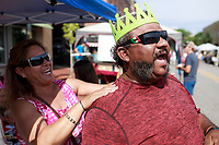 NWA Democrat-Gazette/CHARLIE KAIJO (From right) Kenneth Hernandez and Selena Hernandez of Irving, TX. laugh during the First Friday event, Friday, July 6, 2018 at the Downtown Square in Bentonville. <br /><br />The public was invited to attend the American Past Times themed First Friday event which included food trucks, a barbershop quartet, a bike race and a flag retirement ceremony led by area Boy Scout troops.
