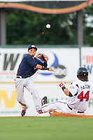 Ronny Torreyes (5) of the Oklahoma City RedHawks makes a throw to first base as Sean Halton (44) of the Nashville Sounds slides into second base at Greer Stadium on July 25, 2014 in Nashville, Tennessee.  The Sounds defeated the RedHawks 2-0.  (Brian Westerholt/Four Seam Images)