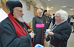 Clare Amos, a program executive for the World Council of Churches, greets Iraqi church leaders during the visit of an ecumenical delegation to Baghdad on January 21, 2017. On the left is Syriac Catholic Archbishop Mor Severios Jamil Hawa of Baghdad & Basra, and behind him is the Chaldean Catholic Bishop Mikha Pola Maqdassi of the Eparchy of Alqosh.