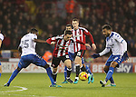 Stefan Scougall of Sheffield United challenged by Leon Barnett of Bury during the English Football League One match at Bramall Lane, Sheffield. Picture date: November 22nd, 2016. Pic Jamie Tyerman/Sportimage
