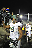 29 November 2014:  Michigan State DE Shilique Calhoun (89) interacts with fans as he leaves the field after the game. The Michigan State Spartans defeated the Penn State Nittany Lions 34-10 at Beaver Stadium in State College, PA.
