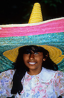 Portrait of smiling Indian girl with big colorfull hat in Mexico