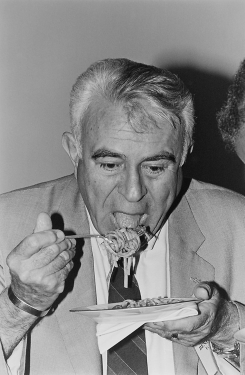 Rep. Benjamin A. Gilman, R-N.Y., taking a bite of pasta at the Centsational Pasta Celebration on Sep. 28, 1993. (Photo by Laura Patterson/CQ Roll Call via Getty Images)