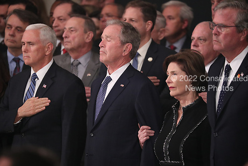 U.S. Vice President Mike Pence, former President George W. Bush and former first lady Laura Bush watch as the casket of former President George H.W. Bush arrives to lie in state in the U.S. Capitol Rotunda in Washington, U.S., December 3, 2018. REUTERS/Jonathan Ernst/Pool