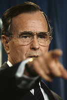 Washington DC., USA, 1989<br /> President George  H.W. Bush points to a reporter to signal that he will take his question next during a press conference in the press briefing room of the White House. Credit: Mark Reinstein/MediaPunch