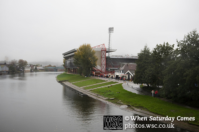 Supporters making their way in the rain over beside the River Trent towards the City Ground, Nottingham to watch their team, Nottingham Forest take on visitors Ipswich Town in an Npower Championship match. Forest won the match by two goals to nil in front of 22,935 spectators.