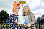 Best lady<br /> ------------<br /> Professional Milliner Maria Stack from Listowel accepts her winning prize for best dressed lady from Mary Stack of the North Kerry Harriors at the Ballybeggan race track last Saturday.