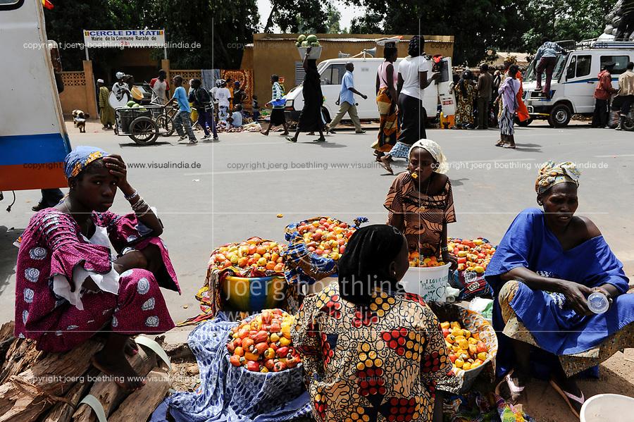 Mali, Dialakoro, market, women sell cashew fruits with nut