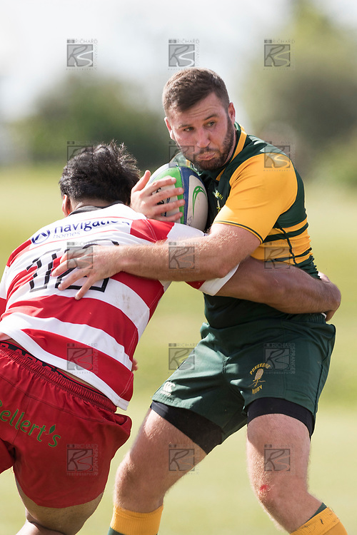 Cardiff Vaega tackles Joe Reynolds. Counties Manukau Premier Counties Power Club Rugby game between Karaka and Pukekohe, played at the Karaka Sports Park on Saturday March 10th 2018. Pukekohe won the game 31 - 27 after trailing 5 - 20 at halftime.<br /> Photo by Richard Spranger.