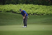 Andy Sullivan (ENG) sends the ball straight to the hole for a birdie on the 4th which kick started a recovery of three consecutive birdies during the Final Round of the 2014 Maybank Malaysian Open at the Kuala Lumpur Golf & Country Club, Kuala Lumpur, Malaysia. Picture:  David Lloyd / www.golffile.ie