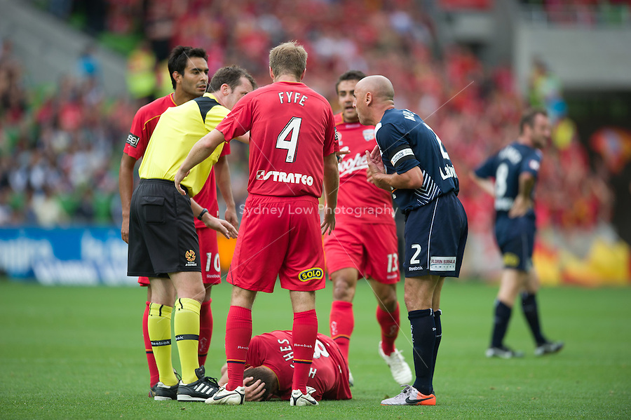 MELBOURNE, AUSTRALIA - JANUARY 09: Kevin Muscat of the Victory reacts after he fouled Adam Hughes of United during the round 22 A-League match between the Melbourne Victory and Adelaide United at AAMI Park on January 9, 2011 in Melbourne, Australia. (Photo by Sydney Low / Asterisk Images)