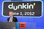 Nigel Travis joins Dunkin Donuts to celebrate 'National Donut Day' as well as unveiling their new Electronic Billboard in Times Square, New York on 6/1/2012© Walter McBride .