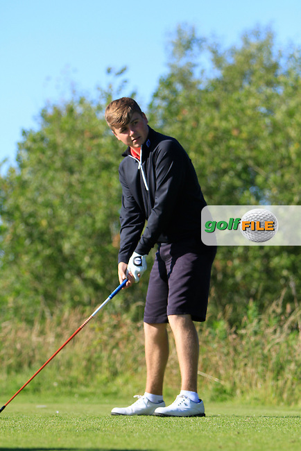 Darragh Smith (Castle) on the 18th tee during the Ulster Boys' Amateur Open Championship in Clandeboye Golf Club on Tuesday 8th July 2014.<br /> Picture:  Thos Caffrey / www.golffile.ie