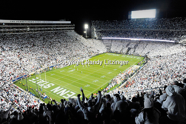 """Penn State fans in the upper level cheer during the 10th ever whole stadium """"white out"""". The Penn State Nittany Lions upset the #2 ranked Ohio State Buckeyes 24-21 at Beaver Stadium in State College, PA."""