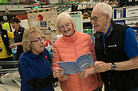 Asda customer Sandra Speyers of Edwalton (centre) meets Barbara Preston and Malcom Ginever of the Breathe Easy group