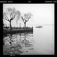 Tour boats afloat on the West Lake in Hangzhou, Zhejiang province, China, March 2013. (Mamiya 6, 75mm, Kodak TRI-X film)