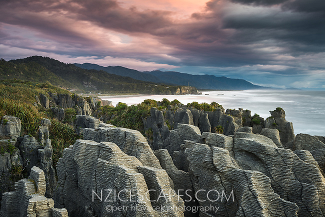 Blowhole at Pancake Rocks, limestone formations in Punakaiki at twilight, Paparoa National Park, West Coast, New Zealand
