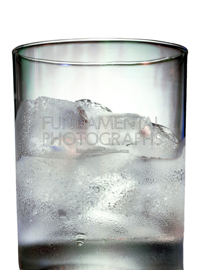 ICE MELTING IN A GLASS WITH CONDENSATION<br />