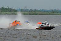 Megan Becan, (#77) gets a face full of water from Butch Ott, (#78) (SST-45 class)