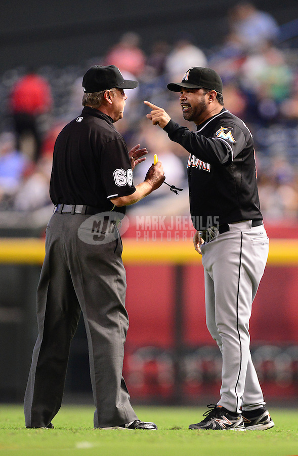 Aug. 22, 2012; Phoenix, AZ, USA: Miami Marlins manager Ozzie Guillen (right) argues with umpire Jim Joyce after being ejected in the third inning against the Arizona Diamondbacks at Chase Field. Mandatory Credit: Mark J. Rebilas-