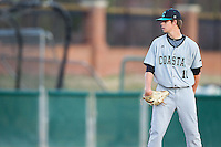 Coastal Carolina Chanticleers starting pitcher Ben Smith (11) looks to his catcher for the sign against the High Point Panthers at Willard Stadium on March 14, 2014 in High Point, North Carolina.  The Panthers defeated the Chanticleers 3-0.  (Brian Westerholt/Four Seam Images)