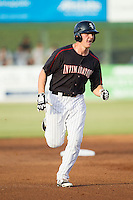 Carl Thomore (13) of the Kannapolis Intimidators rounds the bases after hitting a grand-slam against the Delmarva Shorebirds at CMC-NorthEast Stadium on July 2, 2014 in Kannapolis, North Carolina.  The Intimidators defeated the Shorebirds 6-4. (Brian Westerholt/Four Seam Images)