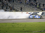 Sprint Cup Series driver Jimmie Johnson (48) does his burn off after winning the Nascar Sprint Cup Series AAA Texas 500 race at Texas Motor Speedway in Fort Worth,Texas. Sprint Cup Series driver Jimmie Johnson (48) wins the AAA Texas 500 race.