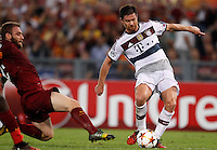 Calcio, Champions League, Gruppo E: Roma vs Bayern Monaco. Roma, stadio Olimpico, 21 ottobre 2014.<br /> Bayern's Xabi Alonso is challenged by Roma's Daniele De Rossi, left, during the Group E Champions League football match between AS Roma and Bayern at Rome's Olympic stadium, 21 October 2014.<br /> UPDATE IMAGES PRESS/Isabella Bonotto