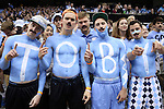 "18 November 2015: UNC fans wear mustaches for Movember and spell out ""Toby"" on their chests in honor of walk-on player Toby Egbuna (not pictured). The University of North Carolina Tar Heels hosted the Wofford College Terriers at the Dean E. Smith Center in Chapel Hill, North Carolina in a 2015-16 NCAA Division I Men's Basketball game. UNC won the game 78-58."
