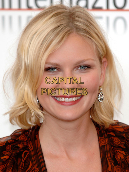 "KIRSTEN DUNST.photocall for ""Elizabethtown"".62nd International Film Festival,.Venice,4th September 2005.portrait headshot La Biennale black red floral pattern v-neck dress .Ref: PL.portrait headshot.www.capitalpictures.com.sales@capitalpictures.com.©Capital Pictures."