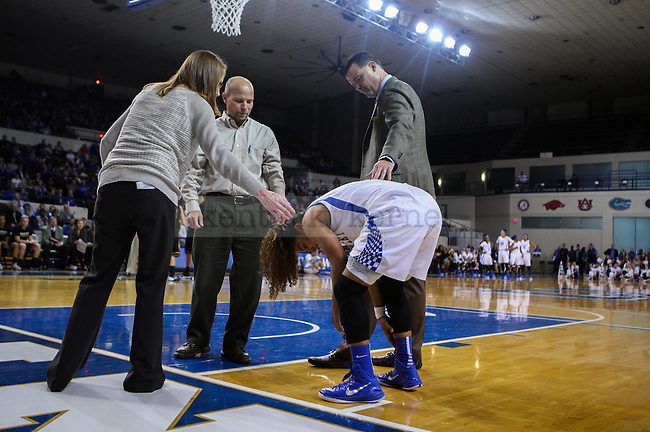 UK Hoops coach Matthew Mitchell consoles guard Jennifer O'Neill following her injury early in the first half at the University of Kentucky versus Northern Kentucky University women's basketball game at Memorial Coliseum in Lexington, Ky., on Wednesday, December 3, 2014. Photo by Cameron Sadler | Staff