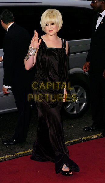 KELLY OSBOURNE.The GQ Men of the Year Awards, Royal Opera House, London, UK..September 5th, 2006.Ref: CAN.full length black dress tattoos bracelets hand waving.www.capitalpictures.com.sales@capitalpictures.com.©Can Nguyen/Capital Pictures