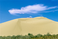 Cloud and sand dune, Great Sand Hills near Leader, Saskatchewan, Canada