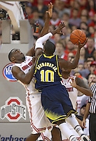Ohio State Buckeyes forward Evan Ravenel (30) plays tight defense against Michigan Wolverines guard Tim Hardaway Jr. (10) in second half action at Value City Arena on January 13, 2012.  (Chris Russell/The Columbus Dispatch)