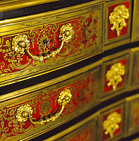 The ornate red-and-gold chest of drawers in the living room once belonged to Andree Putman's grandmother