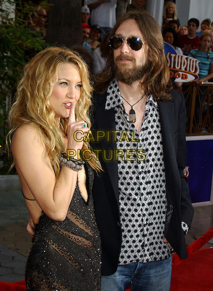 "KATE HUDSON & CHRIS ROBINSON.Universal Pictures' Los Angeles Premiere of ""The Skeleton Key"" held at Universal City Walk in Universal City, California  .August 2nd, 2005.half length married husband wife sunglasses shades beard facial hair quiet finger to mouth gesture.www.capitalpictures.com.sales@capitalpictures.com.Supplied By Capital PIctures"